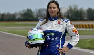 Simona De Silvestro, of Switzerland, poses prior to a training session at Ferrari's Fiorano test track, near Modena, Italy, Saturday, April 26, 2014. Simona de Silvestro is an affiliated driver with Sauber this year with a goal of competing for a Formula One seat in 2015. The Swiss driver has spent the last four years racing in IndyCar, and scored her first career podium in October with a second-place finish at Houston. It was the first podium finish for a woman on a road course in IndyCar. The 25-year-old De Silvestro has been spending this year testing, participating in simulator training and preparing for the mental and physical demands of F1. Sauber says the goal is to help De Silvestro earn her F1 super license and prepare for a seat in 2015. (AP Photo/Marco Vasini)