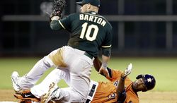 Oakland Athletics first baseman Daric Barton (10) knocks Houston Astros' Dexter Fowler (21) over whil trying to tag him out on a double to center field in the fourth inning of a baseball game on Friday, April 25, 2014, in Houston. (AP Photo/Pat Sullivan)