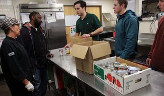 ADVANCE FOR USE SATURDAY, APRIL 26 - In this photo taken on April 16 2014, Food Recovery Network president John Sheeley at the Bedell Entrepreneurship Learning Laboratory in Iowa City, Iowa. (AP Photo/Iowa City Press-Citizen, David Scrivner )  NO SALES