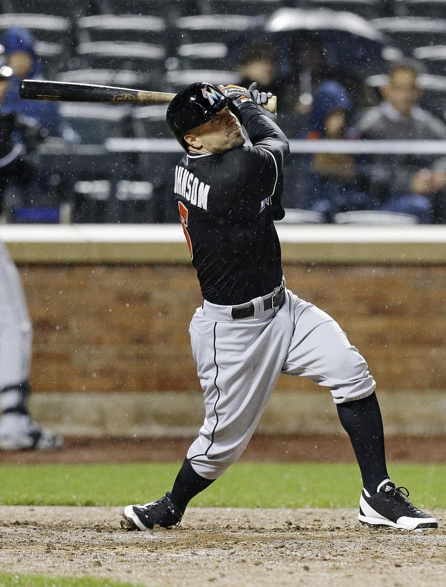 Miami Marlins' Reed Johnson follows through on a two-run double during the sixth inning of a baseball game against the New York Mets, Saturday, April 26, 2014, in New York. (AP Photo/Frank Franklin II)