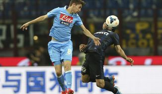 Napoli defender Jorginho of Brazil, left, challenge for the ball with Inter Milan midfielder Anderson Hernanes of Brazil during a Serie A soccer match between Inter Milan and Napoli, at the San Siro stadium in Milan, Italy, Saturday, April 26, 2014. (AP Photo/Luca Bruno)