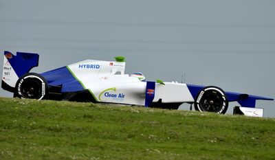 Simona De Silvestro, of Switzerland, steers a Sauber F1 2012 during a training session at Ferrari's Fiorano test track, near Modena, Saturday, April 26, 2014. Simona de Silvestro is an affiliated driver with Sauber this year with a goal of competing for a Formula One seat in 2015. The Swiss driver has spent the last four years racing in IndyCar, and scored her first career podium in October with a second-place finish at Houston. It was the first podium finish for a woman on a road course in IndyCar. The 25-year-old De Silvestro has been spending this year testing, participating in simulator training and preparing for the mental and physical demands of F1. Sauber says the goal is to help De Silvestro earn her F1 super license and prepare for a seat in 2015. (AP Photo/Marco Vasini)