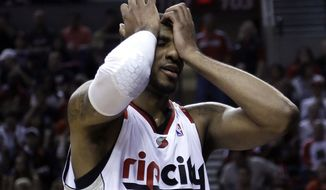 Portland Trail Blazers forward LaMarcus Aldridge reacts after missing a basket on a fast break during the second half of Game 3 of an NBA basketball first-round playoff series against the Houston Rockets in Portland, Ore., Friday, April 25, 2014.  Houston won 121-116.(AP Photo/Don Ryan)