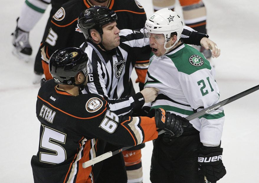 Dallas Stars' Antoine Roussel(21), of France, intimidates Anaheim Ducks' Emerson Etem(65) during the second period of Game 5 of the first-round NHL hockey Stanley Cup playoff series on Friday, April 25, 2014, in Anaheim, Calif. (AP Photo/Jae C. Hong)