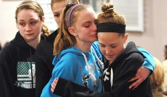 (Peter Casolino-New Haven Register)  Friends and family including many students from Jonathan Law High School attend a memorial service at the First United Church of Christ in Milford, Conn., for Maren Sanchez who was killed at the school Friday April 25, 2014. The 16-year-old girl was stabbed to death inside a Connecticut high school Friday, and police were investigating whether a boy attacked her after she turned down an invitation to be his prom date. (AP Photo/The New Haven Register, Peter Casolino)