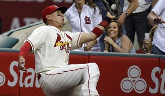 St. Louis Cardinals right fielder Allen Craig catches a ball hit by Pittsburgh Pirates' Gaby Sanchez in foul territory for an out during the sixth inning of a baseball game Saturday, April 26, 2014, in St. Louis. (AP Photo/Jeff Roberson)