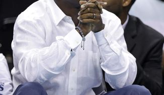 Charlotte Bobcats owner Michael Jordan looks up at the scoreboard during the first half in Game 3 of an opening-round NBA basketball playoff series against the Miami Heat in Charlotte, N.C., Saturday, April 26, 2014. (AP Photo/Chuck Burton)
