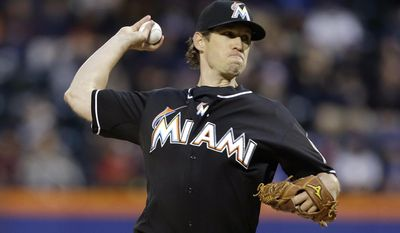 Miami Marlins' Kevin Slowey delivers a pitch during the first inning of a baseball game against the New York Mets, Saturday, April 26, 2014, in New York. (AP Photo/Frank Franklin II)