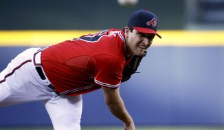 Atlanta Braves starting pitcher David Hale throws in the first inning of a baseball game against the Cincinnati Reds, Saturday, April 26, 2014, in Atlanta. (AP Photo/David Goldman)