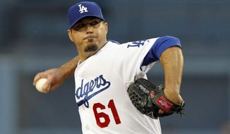 Los Angeles Dodgers starting pitcher Josh Beckett pitches against the Colorado Rockies in the first inning of a baseball game on Friday, April 25, 2014, in Los Angeles. (AP Photo/Alex Gallardo)