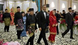 U.S. President Barack Obama arrives with Malaysian King Abdul Halim Mu'adzam Shah, left, and Queen Haminah, right, followed by Malaysian Prime Minister Najib Razak, at the King's Palace or Istana Negara in, Kuala Lumpur, Malaysia, Saturday, April 26, 2014. The last U.S. president to visit Malaysia was Lyndon B. Johnson in 1966. (AP Photo/Carolyn Kaster)