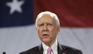 Sen. Orrin Hatch, R-Utah, addresses a crowd during the Utah Republican Party nominating convention, Saturday, April 26, 2014, in Sandy, Utah. About 4,000 Republican delegates are gathered for the convention Saturday to pick the party's candidates for four congressional seats and nine legislative races. (AP Photo/Rick Bowmer)