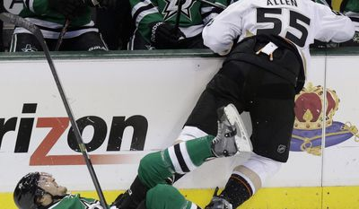 Dallas Stars left wing Ryan Garbutt (16) is knocked to the ice by Anaheim Ducks defenseman Bryan Allen (55) during the first period of Game 6 of a first-round NHL hockey playoff series in Dallas, Sunday, April 27, 2014. (AP Photo/LM Otero)