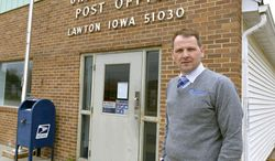 Heath Mallory, general manager of Western Iowa Telephone,  stands outside the post office in Lawton, Iowa, Thursday April 24, 2014. With post office closing at 2 p.m. on weekdays Mallory says it is harder to get mailings out before closing.  (AP Photo/The Sioux City Journal, Tim Hynds)