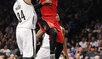 Brooklyn Nets forward Paul Pierce (34) defends against Toronto Raptors guard DeMar DeRozan (10) as DeRozan goes up for a layup in the first half of Game 4 of an NBA basketball first-round playoff series at the Barclays Center, Sunday, April 27, 2014, in New York. (AP Photo/Kathy Willens)