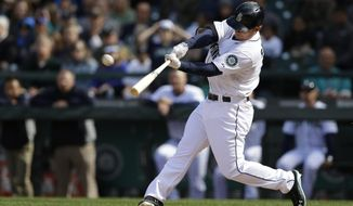 Seattle Mariners' Kyle Seager hits a three-run go-ahead home run in the eighth inning of a baseball game against the Texas Rangers, Sunday, April 27, 2014, in Seattle. (AP Photo/Ted S. Warren)
