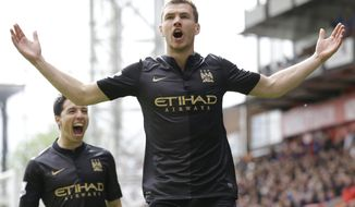 Manchester City's Edin Dzeko, right, celebrates with Samir Nasri after he scores a goal during the English Premier League soccer match between Crystal Palace and Manchester City at Selhurst Park stadium in London, Sunday, April 27, 2014. (AP Photo/Kirsty Wigglesworth)