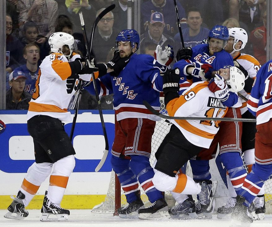 Philadelphia Flyers' Jakub Voracek, left, New York Rangers' Anton Stralman, second from left, Rangers' Marc Staal (18), second from right, and Flyers' Scott Hartnell (19) scuffle in front of the goal during the second period of Game 5 of an NHL hockey first-round playoff series on Sunday, April 27, 2014, in New York. (AP Photo/Seth Wenig)