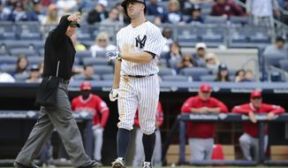 New York Yankees' Brett Gardner reacts after getting hit by a pitch from Los Angeles Angels relief pitcher Ernesto Frieri in the eighth inning of a baseball game at Yankee Stadium, Saturday, April 26, 2014, in New York. The Yankees won, 4-3. (AP Photo/John Minchillo)