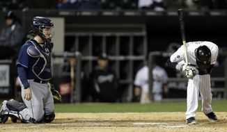 Chicago White Sox's Alexei Ramirez, right, reacts to a called strike as Tampa Bay Rays catcher Ryan Hanigan looks on during the ninth inning of a baseball game in Chicago, Saturday, April 26, 2014. The Rays won 4-0. (AP Photo/Nam Y. Huh)