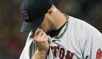 Boston Red Sox starting pitcher Jon Lester walks off the field during the third inning of a baseball game against the Toronto Blue Jays in Toronto on Sunday, April 27, 2014. (AP Photo/The Canadian Press, Frank Gunn)