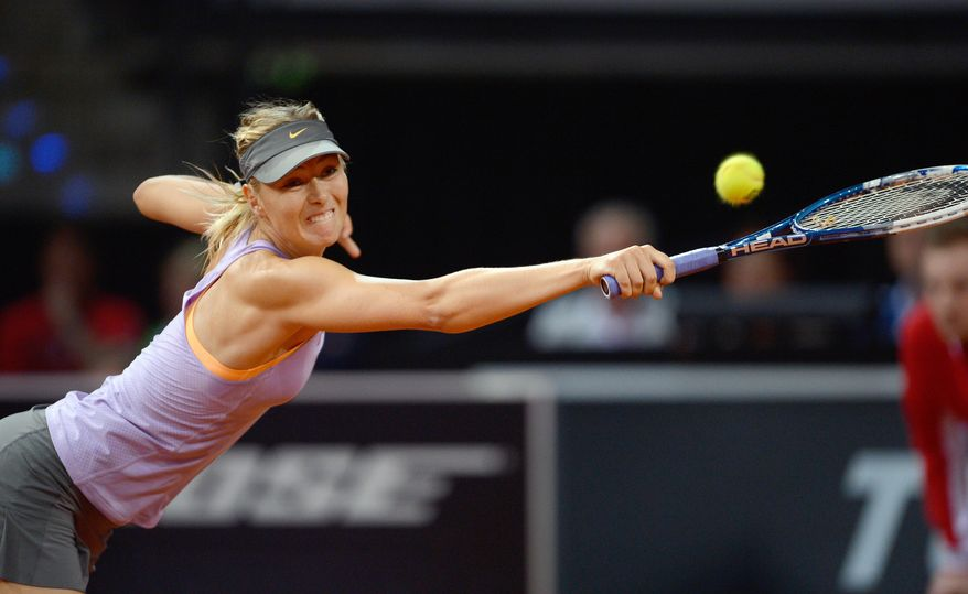 Russia's Maria Sharapova returns the ball to Serbia's Ana Ivanovic during their final match at the Porsche tennis Grand Prix in Stuttgart, Germany, Sunday, April 27, 2014. (AP Photo/dpa, Daniel Maurer)