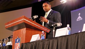 FILE - In this file photo taken Jan. 31, 2013, former NFL player Troy Vincent speaks during an NFL Player Health and Safety news conference in New Orleans. Vincent, the new director of football operations, can see in the NFL's future a developmental league, an eighth official on the field for games, and coaches using tablets on the sidelines to call plays, said in an interview Friday, April 25, 2014. Vincent, president of the players' union, recently replaced Ray Anderson, who left the league to become athletic director at Arizona State. (AP Photo/Doug Benc, file)