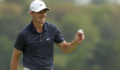 In this photo released by OneAsia, Tommy Fleetwood of England holds the ball during the final round of the Volvo China Open at Genzon Golf Club in Shenzhen, southern China, Sunday, April 27, 2014. Alexander Levy of France held on to win his maiden European Tour title at the China Open on Sunday, recovering from a late double bogey to shoot a 69 and beat Fleetwood by four strokes. (AP Photo/OneAsia, Paul Lakatos) NO LICENSING