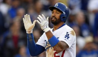 Los Angeles Dodgers' Matt Kemp celebrates after hitting a solo home run during the third inning of a baseball game against the Colorado Rockies, Saturday, April 26, 2014, in Los Angeles. (AP Photo/Mark J. Terrill)