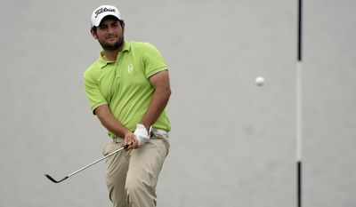 In this photo released by OneAsia, Alexander Levy of France watches his shot during the final round of the Volvo China Open at Genzon Golf Club in Shenzhen, southern China, Sunday, April 27, 2014. Levy held on to win his maiden European Tour title at the China Open on Sunday, recovering from a late double bogey to shoot a 69 and beat Tommy Fleetwood by four strokes. (AP Photo/OneAsia, Paul Lakatos) NO LICENSING