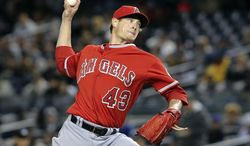 Los Angeles Angels starting pitcher Garrett Richards throws in the first inning their baseball game against the New York Yankees at Yankee Stadium, Sunday, April 27, 2014, in New York. (AP Photo/John Minchillo)