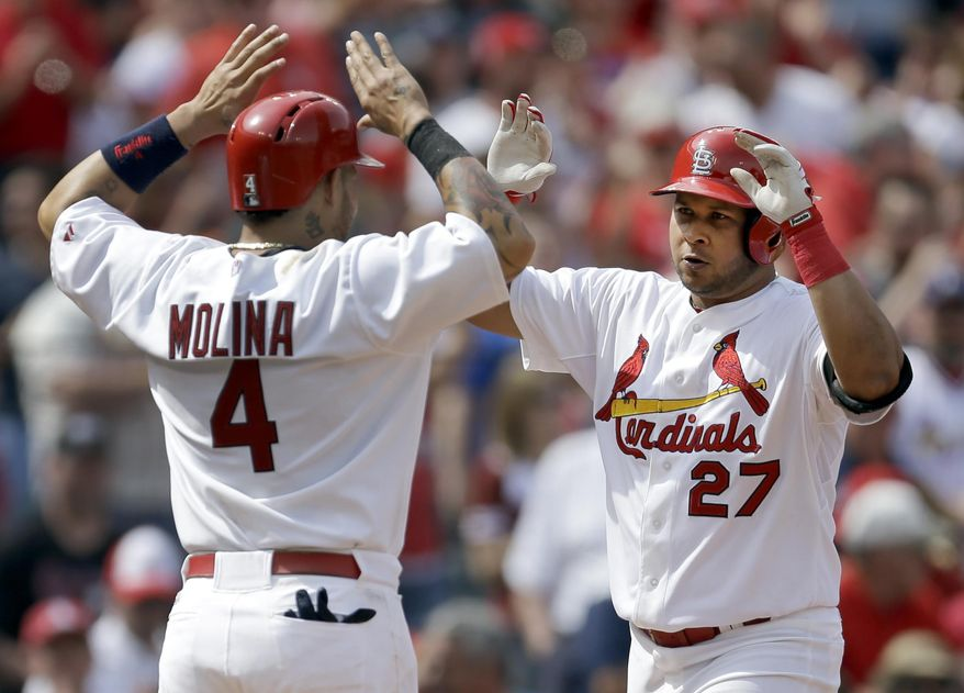 St. Louis Cardinals' Jhonny Peralta, right, is congratulated by teammate Yadier Molina after hitting a three-run home run during the sixth inning of a baseball game against the Pittsburgh Pirates, Sunday, April 27, 2014, in St. Louis. (AP Photo/Jeff Roberson)