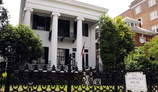ADVANCE FOR USE MONDAY, APRIL 28 - This photo taken on April 22, 2011 shows the exterior of the Cannonball House in Macon, Ga. The house got the name because it was struck with a cannonball fired from a mile away by Union troops.  (AP Photo/The Macon Telegraph, Woody Marshall)