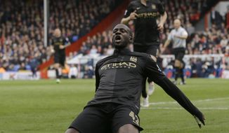 Manchester City's Yaya Toure celebrates after he scores a goal during the English Premier League soccer match between Crystal Palace and Manchester City at Selhurst Park stadium in London, Sunday, April 27, 2014. (AP Photo/Kirsty Wigglesworth)