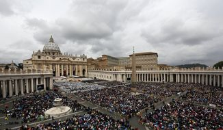 Faithful gather in St. Peter's Square at the Vatican, Sunday, April 27, 2014.  Pope Francis has declared his two predecessors John XXIII and John Paul II saints in an unprecedented canonization ceremony made even more historic by the presence of retired Pope Benedict XVI.(AP Photo/Alessandra Tarantino)