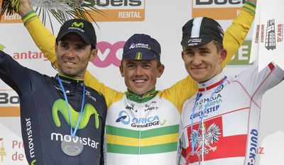 Australia's Simon Gerrans of the Orica Greenedge team, center, celebrates on the podium after winning the 100th edition of the Belgian cycling classic and UCI World Tour race Liege-Bastogne-Liege with Spain's second placed Alejandro Valverde of the Movistar team, left, and third placed Poland's Michal Kwiatowski of the Omega Pharma team, in Ans, Belgium, Sunday, April 27, 2014. (AP Photo/Yves Logghe)