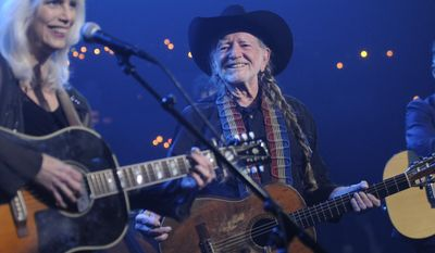 Emmylou Harris, left, performs with Willie Nelson during Austin City Limits Hall of Fame on Saturday night April 26, 2014. Nelson, who will celebrate his 81st birthday next week by receiving his fifth-degree black belt in martial arts, was the first Austin City Limits performer in 1974 on what is now the longest-running television music program in the U.S.  (AP Photo/Courtesy of KLRU, Scott Newton)