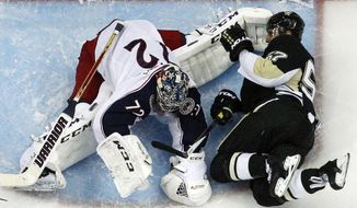 Pittsburgh Penguins' Marcel Goc (57) collides with Columbus Blue Jackets goalie Sergei Bobrovsky during the third period of Game 5 of a first-round NHL playoff hockey series in Pittsburgh, Saturday, April 26, 2014. The Penguins won 3-1. (AP Photo/Gene J. Puskar)