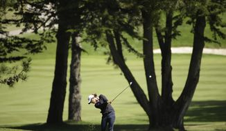 Lydia Ko, of New Zealand, hits an approach shot to the fifth green of Lake Merced Golf Club during the final round of the Swinging Skirts LPGA Classic golf tournament on Sunday, April 27, 2014, in Daly City, Calif. (AP Photo/Eric Risberg)