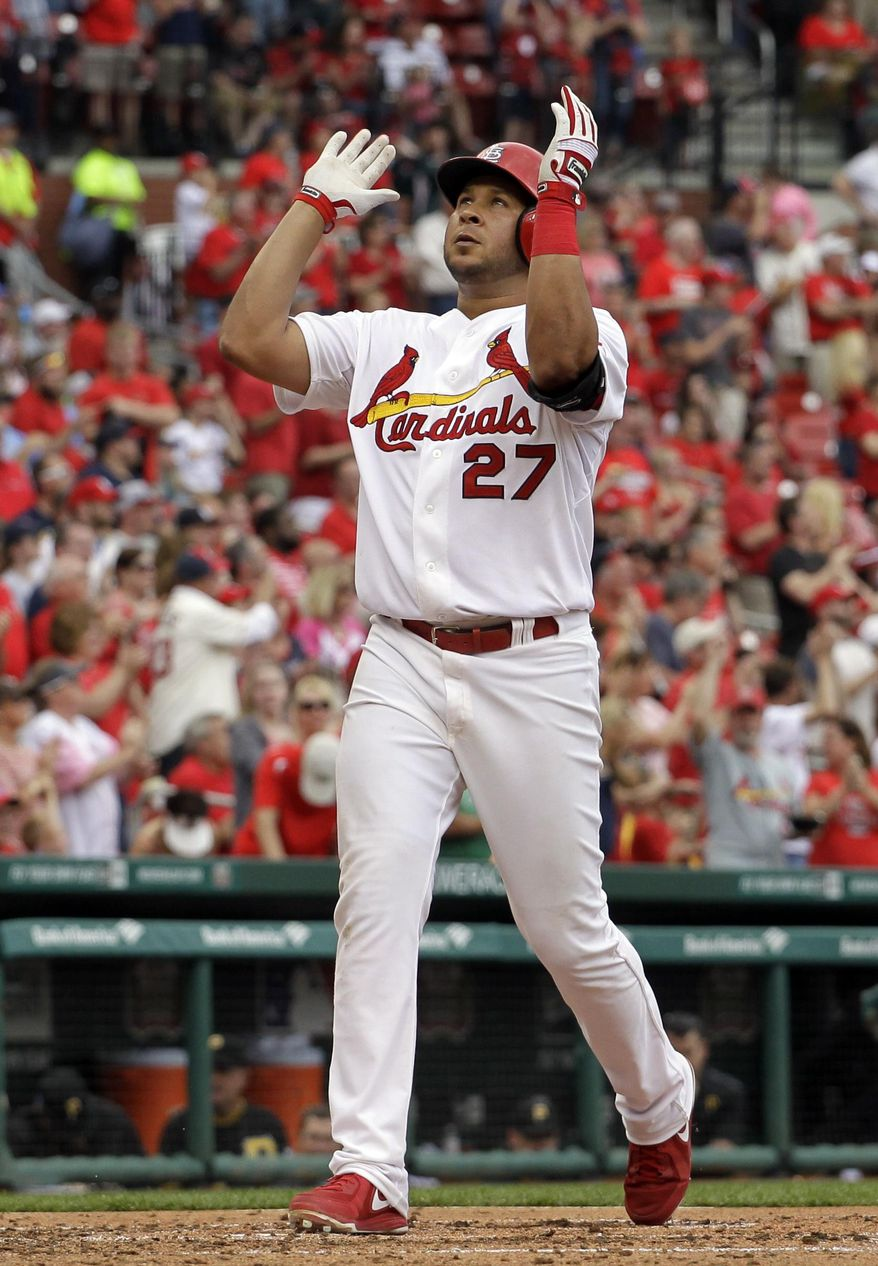 St. Louis Cardinals' Jhonny Peralta celebrates as he reaches home after hitting a solo home run during the fifth inning of a baseball game against the Pittsburgh Pirates, Sunday, April 27, 2014, in St. Louis. Peralta also hit a three-run home run in the sixth inning to help the Cardinals to a 7-0 victory. (AP Photo/Jeff Roberson)