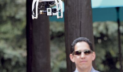 Brian Tercero,  of Keller Williams Realty,  uses a drone to create a high definition video of a property that he is trying to sell for a client, April 18, 2014.  He fells Video footage from a drone can better convey the appeal of a property than standard marketing photos.   (AP Photo/The Santa Fe New Mexican, Clyde Mueller)
