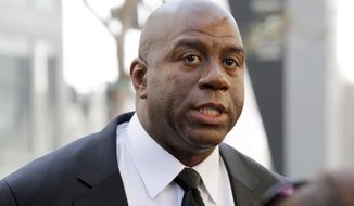 """FILE - In this Feb. 21, 2013, file photo, former Los Angeles Lakers player Earvin """"Magic"""" Johnson arrives at a memorial service for Jerry Buss in Los Angeles. Johnson is calling upon NBA Commissioner Adam Silver to """"come down hard"""" on Los Angeles Clippers owner Donald Sterling, who is alleged to have made racially charged comments. Johnson was a subject of the comments Sterling allegedly made on an audio recording obtained and released by TMZ. (AP Photo/Reed Saxon, File)"""