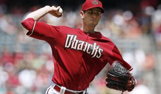 Arizona Diamondbacks' Brandon McCarthy throws a pitch against the Philadelphia Phillies during the first inning of a baseball game on Sunday, April 27, 2014, in Phoenix. (AP Photo/Ross D. Franklin)