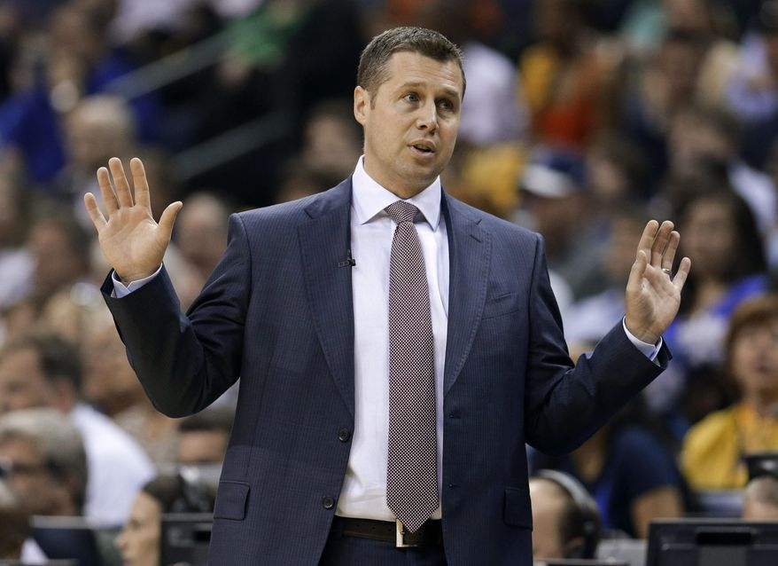 Memphis Grizzlies coach David Joerger reacts to an official's call in the first half of Game 4 of an opening-round NBA basketball playoff series between the Grizzlies and the Oklahoma City Thunder on Saturday, April 26, 2014, in Memphis, Tenn. (AP Photo/Mark Humphrey)