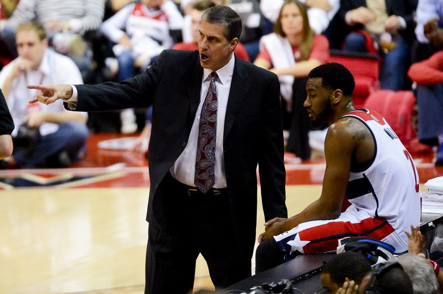 Washington Wizards head coach Randy Wittman talks with Washington Wizards guard John Wall (2) in the second half as the Chicago Bulls play the Washington Wizards in game 4 of the first round of the playoffs at the Verizon Center, Washington, D.C., Sunday, April 27, 2014. The Washington Wizards defeated the Chicago Bulls 98-89. (Andrew Harnik/The Washington Times)