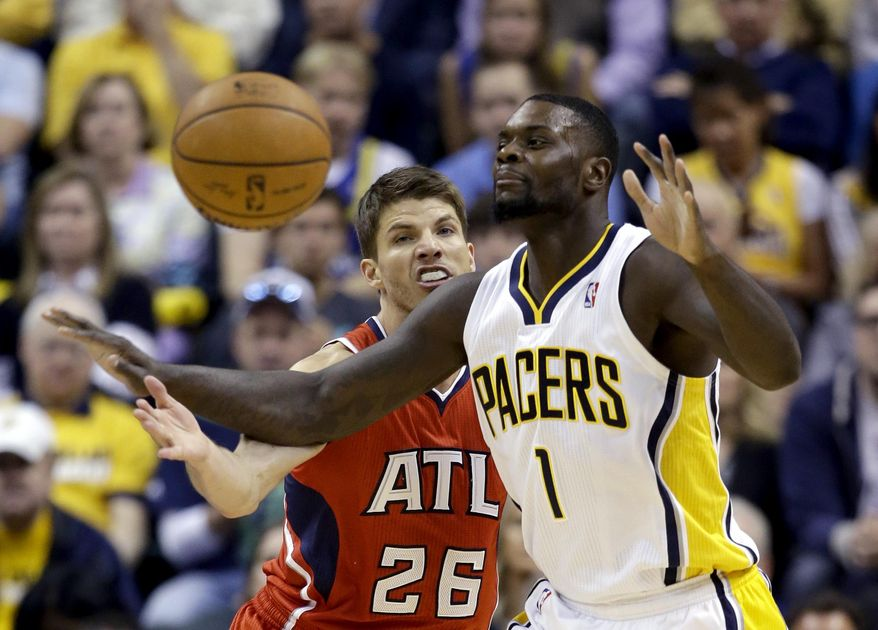 Indiana Pacers' Lance Stephenson (1) loses control of the ball as Atlanta Hawks' Kyle Korver (26) defends during the first half in Game 5 of an opening-round NBA basketball playoff series Monday, April 28, 2014, in Indianapolis. (AP Photo/Darron Cummings)