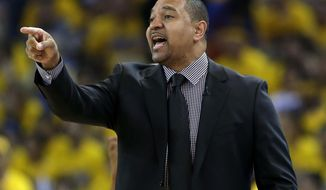 Golden State Warriors head coach Mark Jackson instructs his team against the Los Angeles Clippers during the first half in Game 4 of an opening-round NBA basketball playoff series on Sunday, April 27, 2014, in Oakland, Calif. (AP Photo/Marcio Jose Sanchez)
