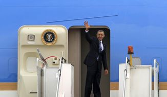 President Barack Obama waves as he boards Air Force One at the Royal Malaysian Air Force base in Subang, Malaysia, Monday, April 28, 2014, before heading to Ninoy Aquino International Airport in Pasay, Philippines. (AP Photo/Lai Seng Sin)