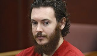 FILE - This June 4, 2013 file photo shows Aurora theater shooting suspect James Holmes in court in Centennial, Colo. Prosecutors in the Colorado theater shooting case are hinting they might want to search for additional evidence or look for more documents, although they aren't publicly saying why. In a motion filed Friday and released Monday, April 28, 2014, prosecutors asked the judge to keep secret any future requests they might make for search warrants or for court orders to produce records. Holmes pleaded not guilty by reason of insanity to multiple counts of murder and attempted murder in the 2012 attack on a suburban Denver movie theater, which killed 12 people and injured 70. Prosecutors are seeking the death penalty. His trial is scheduled to start in October. (AP Photo/The Denver Post, Andy Cross, Pool, File)