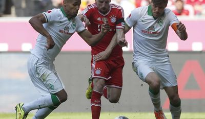 Bayern's Franck Ribery of France, center, Bremen's Theodor Gebre Selassie of Czech Republic, left, and Bremen's Clemens Fritz challenge for the ball during the German first division Bundesliga soccer match between FC Bayern Munich and SV Werder Bremen in Munich, southern Germany, Saturday, April 26, 2014. (AP Photo/Matthias Schrader)
